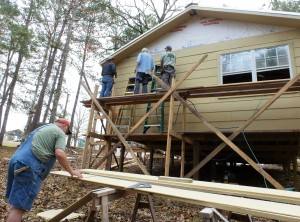 Wayne, Les, and George up and Gary down, working on back side siding.