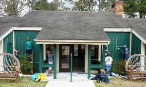 Ladies painting the exterior of one of the lodges.