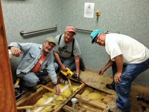 Roger, Don and Dan at work repairing one of the bath floors.
